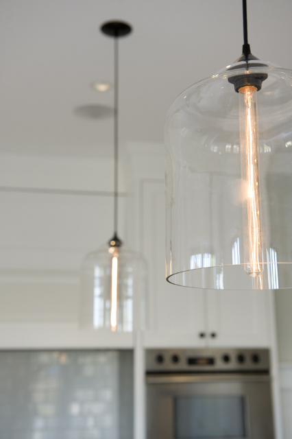 Contemporary kitchen lighting spotted in chic canadian kitchen for Modern island pendant lighting