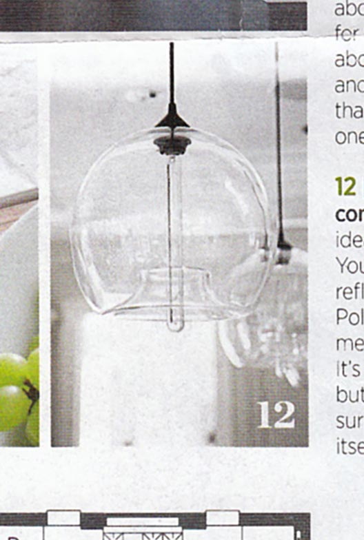 Kitchen island lighting featured in traditional home magazine for Modern island pendant lighting