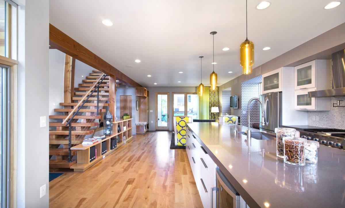 denver house features pharos pendant lights over kitchen island