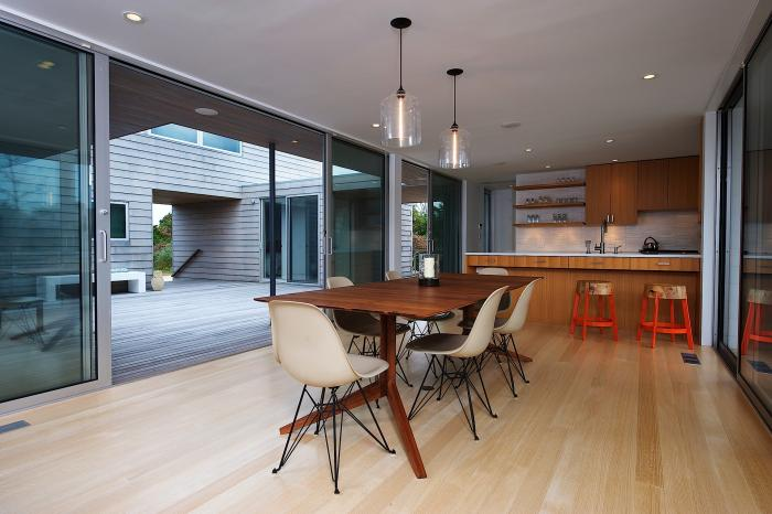 Bell Jar Pendant Lights Hanging over a Dining Room Table in Amagansett