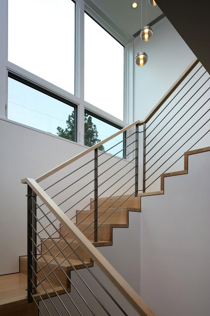 Bocci Lights hang above the stairwell at this private residence by Stelle Architects